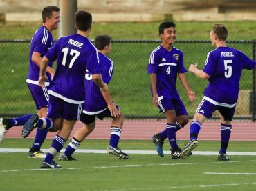 Christian Bernal (4, center) of Monroe celebrates with teammates after he scored late in the first half of boys soccer action against East Brunswick Thursday evening.  9/7/17  (Andrew Mills | NJ Advance Media for NJ.com) NJ Advance Media for NJ.com